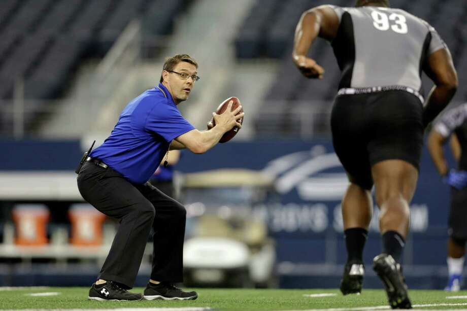 John Aaron, left, runs a drill for defensive tackle Tommy Duhart (93) during the NFL super regional football combine Sunday, April 7, 2013, in Arlington, Texas. (AP Photo/Tony Gutierrez) Photo: Associated Press