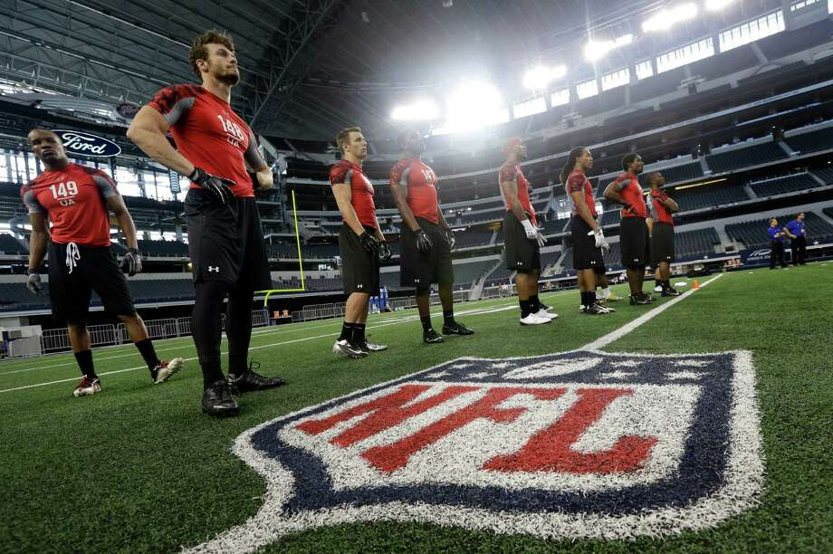 Lenoir-Rhyne wide receiver Justin McCombs (149) and  San Diego wide receiver John Matthews (148) stand alongside other receivers as they participate in position drills during the NFL super regional football scouting combine Monday, April 8, 2013, in Arlington, Texas. (AP Photo/Tony Gutierrez) Photo: Associated Press