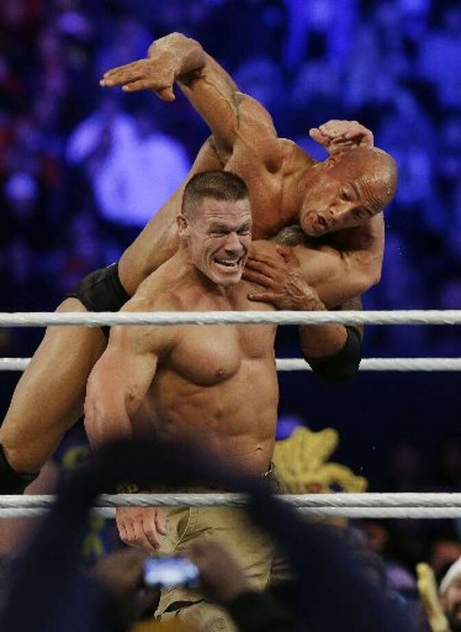 John Cena beat The Rock for the WWE title in the main event.