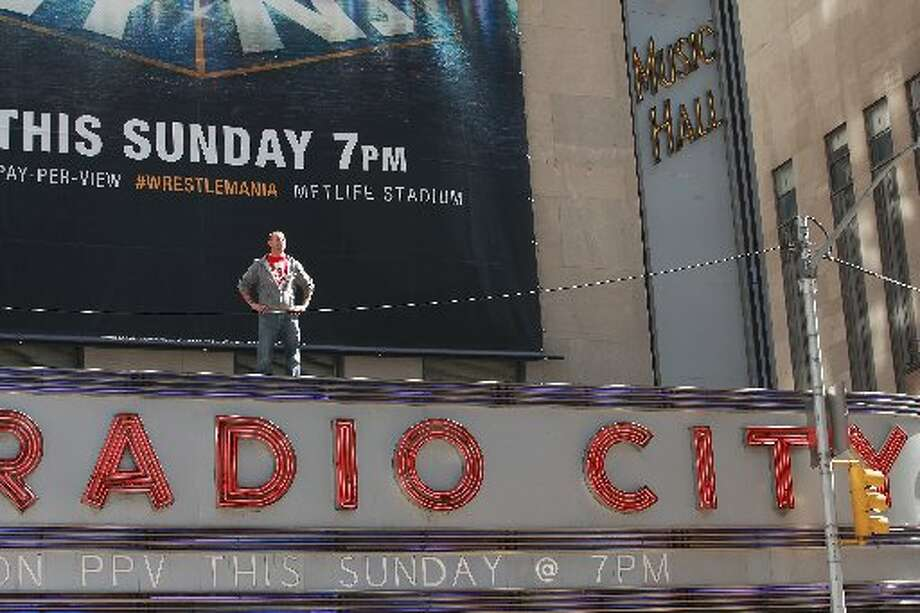 CM Punk stands on top of Radio City Music Hall.