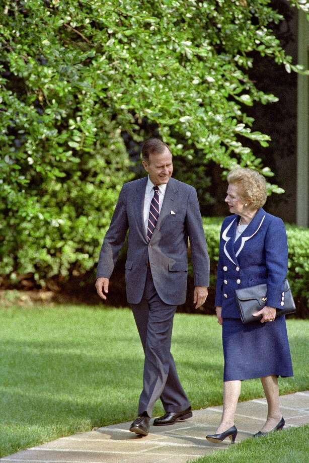 "(FILES) - A picture dated June 20, 1991 shows US President George Bush (L) walking with former British Prime Minister Margaret Thatcher (R) as they leave the Oval Office at the White House. Former British prime minister Margaret Thatcher, the ""Iron Lady"" who shaped a generation of British politics, died following a stroke on April 8, 2013 at the age of 87, her spokesman said.  AFP PHOTO/FILES/LUKE FRAZZALUKE FRAZZA/AFP/Getty Images Photo: LUKE FRAZZA, AFP/Getty Images / AFP"