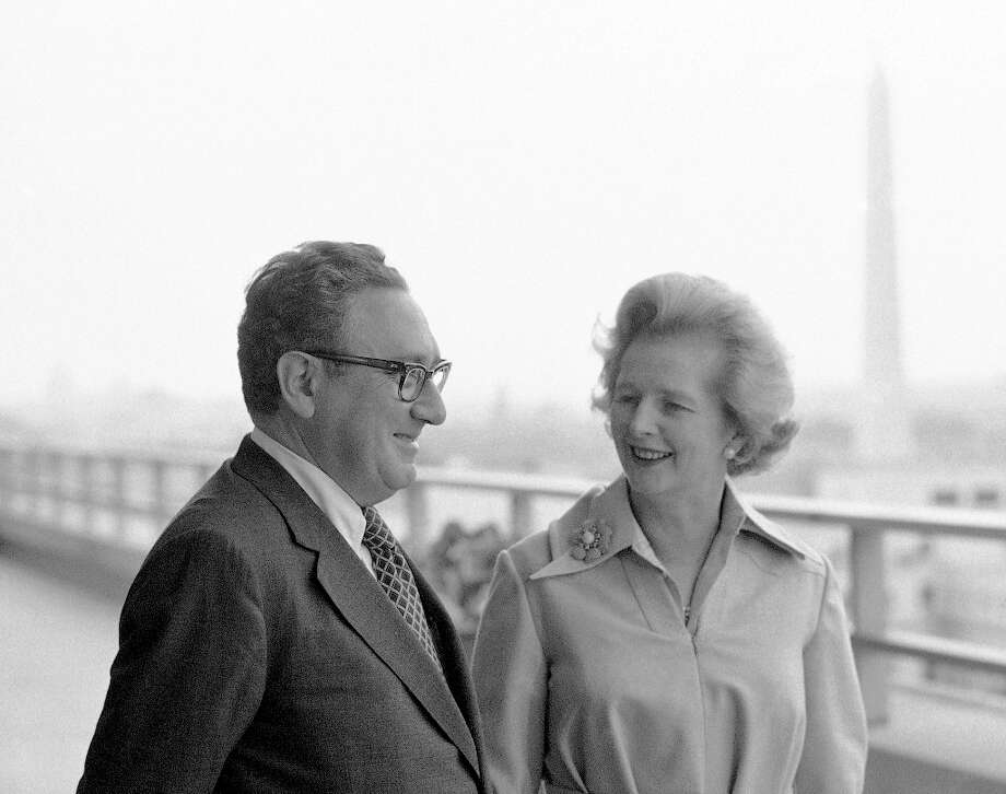FILE - In a Sept. 18,1975 file photo, Margaret Thatcher, right, leader of Great Britain's Conservative party, is given a look at the Capitol from a balcony of the State Department during a breakfast meeting in Washington, by U.S. Secretary of State Henry Kissinger. In background is the Washington Monument. Thatchers former spokesman, Tim Bell, said that the former British Prime Minister Margaret Thatcher died Monday morning, April 8, 2013, of a stroke. She was 87.(AP Photo/Bob Daugherty, File) Photo: Bob Daugherty, Associated Press / AP