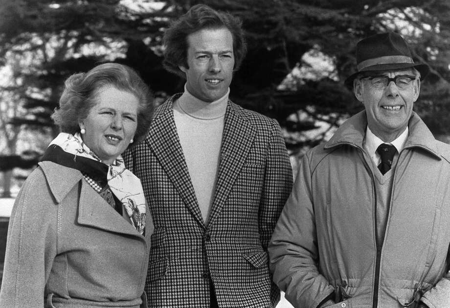 "(FILES) In a file picture taken on 16 January, 1982, Mark Thatcher (C) stands nexts to his mother, British Prime Minister Margaret Thatcher (L), and father Denis Thatcher (R). Mark Thatcher, recently went missing for six days while competing in the Paris-Dakar rally. Former British prime minister Margaret Thatcher, the ""Iron Lady"" who shaped a generation of British politics, died following a stroke on April 8, 2013 at the age of 87, her spokesman said. AFP PHOTO/FILESSTAFF/AFP/Getty Images Photo: STAFF, AFP/Getty Images / AFP ImageForum"