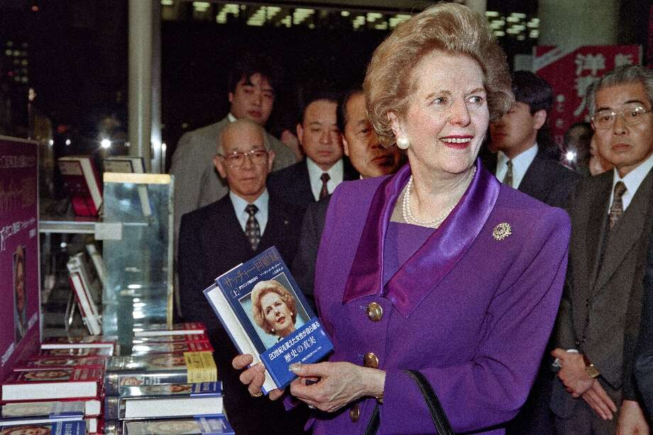 """(FILES) - A picture dated November 26, 1993 shows former British Prime Minister Margaret Thatcher holding her book """"The Downing Street Years"""" during a visit to a bookstore in Tokyo to promote her memoirs, recently translated into Japanese. Former British prime minister Margaret Thatcher, the """"Iron Lady"""" who shaped a generation of British politics, died following a stroke on April 8, 2013 at the age of 87, her spokesman said. AFP PHOTO/TORU YAMANAKATORU YAMANAKA/AFP/Getty Images Photo: TORU YAMANAKA, AFP/Getty Images / AFP"""