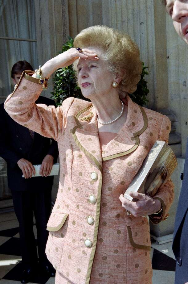 (FILES) - A picture dated June 22, 1995 shows former British Prime Minister Margaret Thatcher posing in front of the Place de la Concorde at the hotel Crillon balcony in Paris, where she is presenting the second tome of her memoirs. AFP PHOTO/GERARD FOUETGERARD FOUET/AFP/Getty Images Photo: GERARD FOUET, AFP/Getty Images / AFP