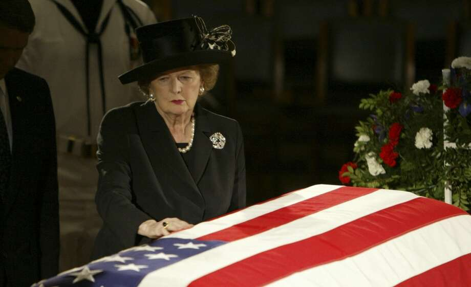 FILE - In this June 9, 2004 file photo, former British Prime Minister Margaret Thatcher pauses at the casket of former U.S. President Ronald Reagan where he was lying in state in the Capitol Rotunda on Capitol Hill in Washington. Thatchers former spokesman, Tim Bell, said that the former British Prime Minister Margaret Thatcher died Monday morning, April 8, 2013, of a stroke.  She was 87. (AP Photo/Ron Edmonds, File) Photo: Ron Edmonds, Associated Press / AP