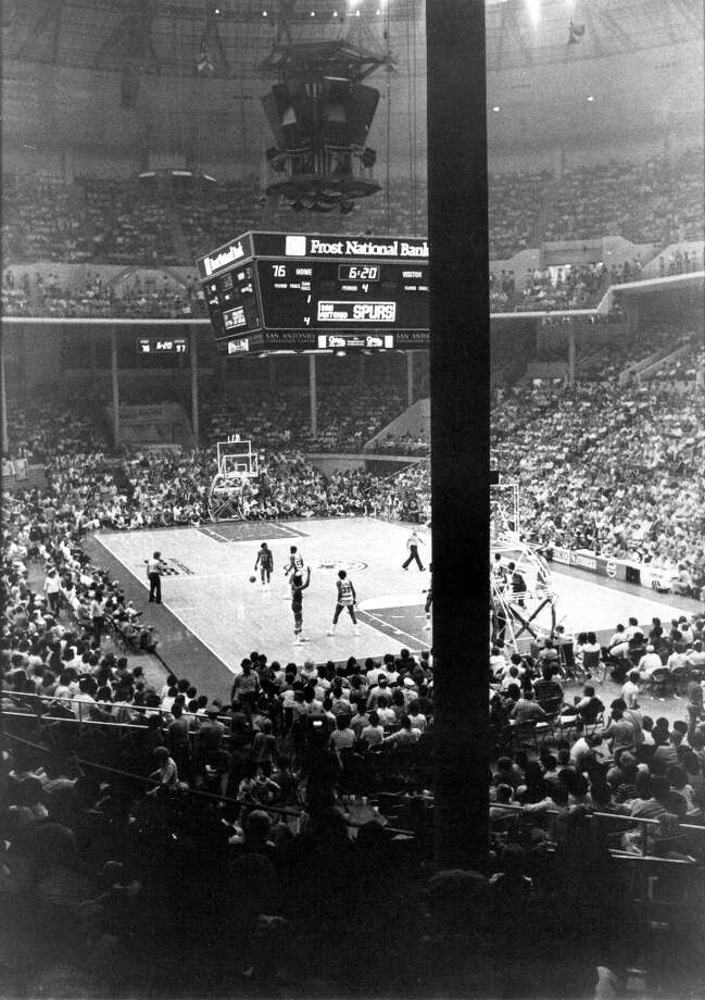 """Obstructed view\"" seating often provided a cheap way to see Spurs games in the pillar-laden HemisFair Arena, the team\'s original home court. The team, shown in this 1979 file photo, focused more on offensive scoring in the days when NBA players had big hair, short-shorts and long tube socks. FILE PHOTO Photo: STEVE KRAUSS, FILE / SAN ANTONIO EXPRESS-NEWS"