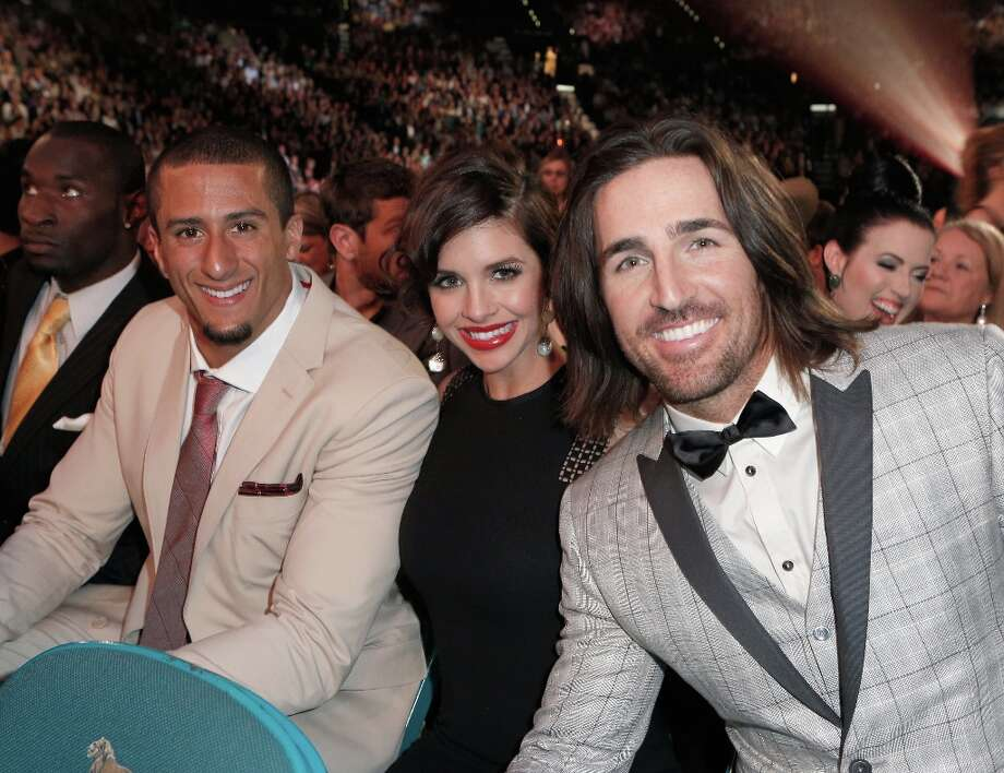 (L-R) NFL player Colin Kaepernick, Lacey Buchanan Owen and musician Jake Owen attend the 48th Annual Academy of Country Music Awards at the MGM Grand Garden Arena on April 7, 2013 in Las Vegas, Nevada. Photo: Mike Windle/ACMA2013, Getty Images For ACM / Mike Windle/ACMA2013