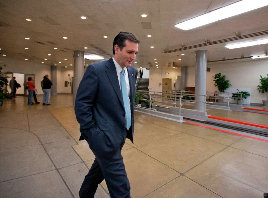 Sen. Ted Cruz, R-Texas walks through the Capitol complex in Washington, Friday, March 22, 2013, after his attempt to overturn the Affordable Care Act was defeated during a flurry of votes on amendments to the budget resolution. (AP Photo/J. Scott Applewhite) Photo: J. Scott Applewhite, Associated Press / AP