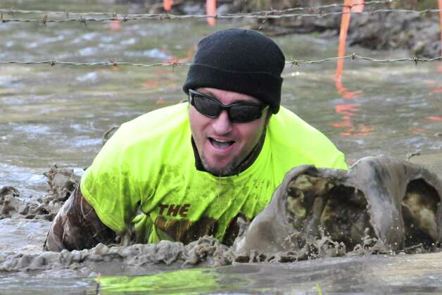 More than 130 people participated in The Mud Farm s first 5K Mud Run/Walk on April 6. The group gathered at 16025 GW Jones Rd. in Sour Lake for a warm up dance to blaring music before hitting the more than three mile trek through mud and the wooded area. Participants crawled through mud, walked planks over water and were pelted with water balloons before crossing the finish line. Proceeds from the event will go to the American Cancer Society, in honor of The Mud Farm s owner, who has been
