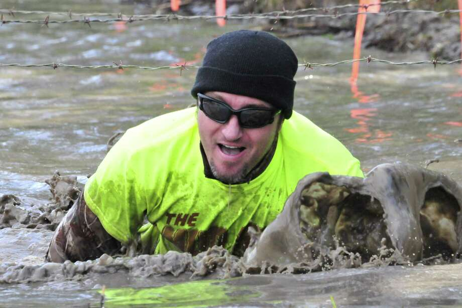 More than 130 people participated in The Mud Farm s first 5K Mud Run/Walk on April 6. The group gathered at 16025 GW Jones Rd. in Sour Lake for a warm up dance to blaring music before hitting the more than three mile trek through mud and the wooded area. Participants crawled through mud, walked planks over water and were pelted with water balloons before crossing the finish line. Proceeds from the event will go to the American Cancer Society, in honor of The Mud Farm s owner, who has been battling cancer for several years. For more information, go to facebook.com/mudrun5k. Photo: Cassie Smith