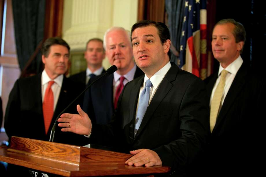 Senator Ted Cruz speaks during a news conference at the Capitol in Austin, Texas, on Monday, April 1, 2013. Cruz, along with other Republican officials, announced that they believe that Medicaid is a broken system, and that expanding it under the Affordable Care Act is the wrong move for Texas. Shown, from left, are Governor Rick Perry, US Senator John Cornyn and  Lt. Gov. David Dewhurst. (AP Photo/Austin American-Statesman, Deborah Cannon) Photo: Deborah Cannon, Associated Press