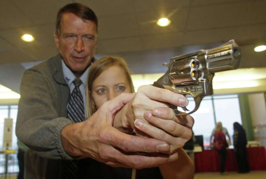 FILE - In this Dec. 27, 2012 file photo, Cori Sorensen, a fourth grade teacher from Highland Elementary School in Highland, Utah, receives firearms training with a .357 magnum from personal defense instructor Jim McCarthy in West Valley City, Utah, where teachers and administrators are allowed to bring guns to school. Lawmakers in many Republican-led states proposed arming school personnel with guns following a mass shooting at a Connecticut school, yet four months later the quest has stalled in many traditionally gun-friendly states. (AP Photo/Rick Bowmer, File) Photo: Rick Bowmer, STF / AP