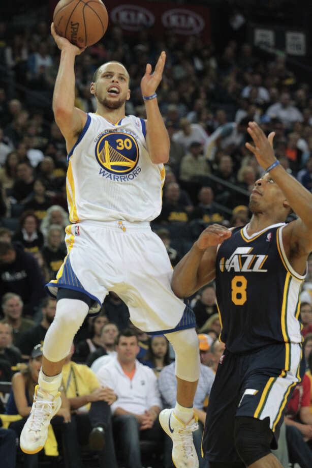 The Warriors\' Stephen Curry puts up a shot over Utah\'s Randy Foye during a game against the Jazz in Oakland, Calif., on Sunday, April 7, 2013. The Jazz won 97-90. Photo: Mathew Sumner, Special To The Chronicle / ONLINE_YES