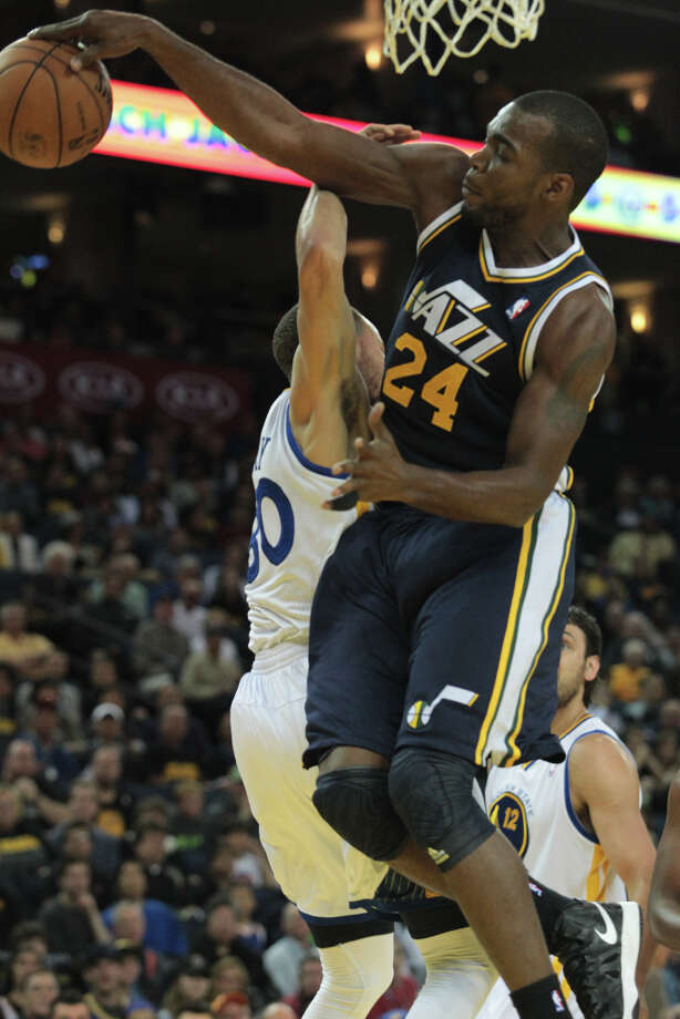 Utah\'s Paul Millsap blocks a shot by the Warriors\' Stephen Curry during a game in Oakland, Calif., on Sunday, April 7, 2013. Photo: Mathew Sumner, Special To The Chronicle / ONLINE_YES