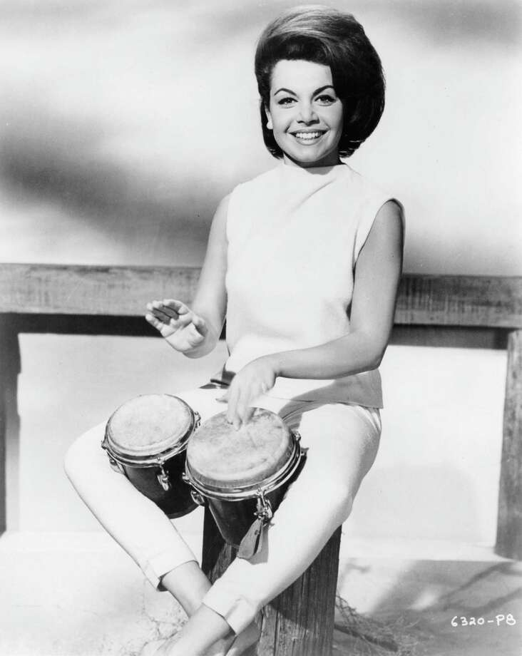 Annette Funicello plays the bongos in publicity portrait from the film 'Beach Party', 1963. Photo: Archive Photos, File / 2012 Getty Images