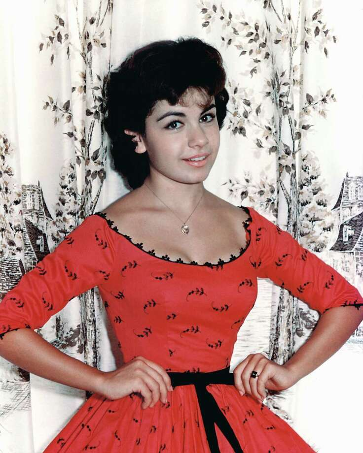 Annette Funicello, US actress and singer, wearing a red dress with black motifs and a scoop neckline, circa 1960. Photo: Silver Screen Collection, File / Moviepix
