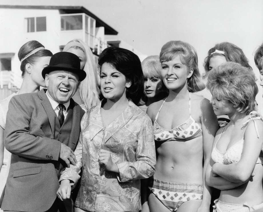 Mickey Rooney and Annette Funicello surrounded by bikini girls in a scene from the film 'How To Stuff A Wild Bikini', 1965. Photo: Archive Photos, File / 2011 Getty Images