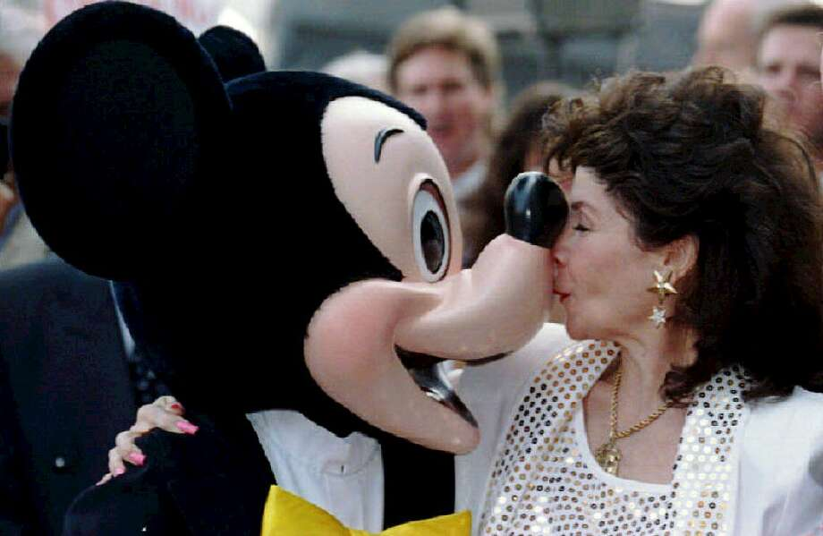 Annette Funicello kisses Mickey Mouse in 1993 after she received a star on the famous Hollywood Walk of Fame in California. Photo: VINCE BUCCI, File / AFP