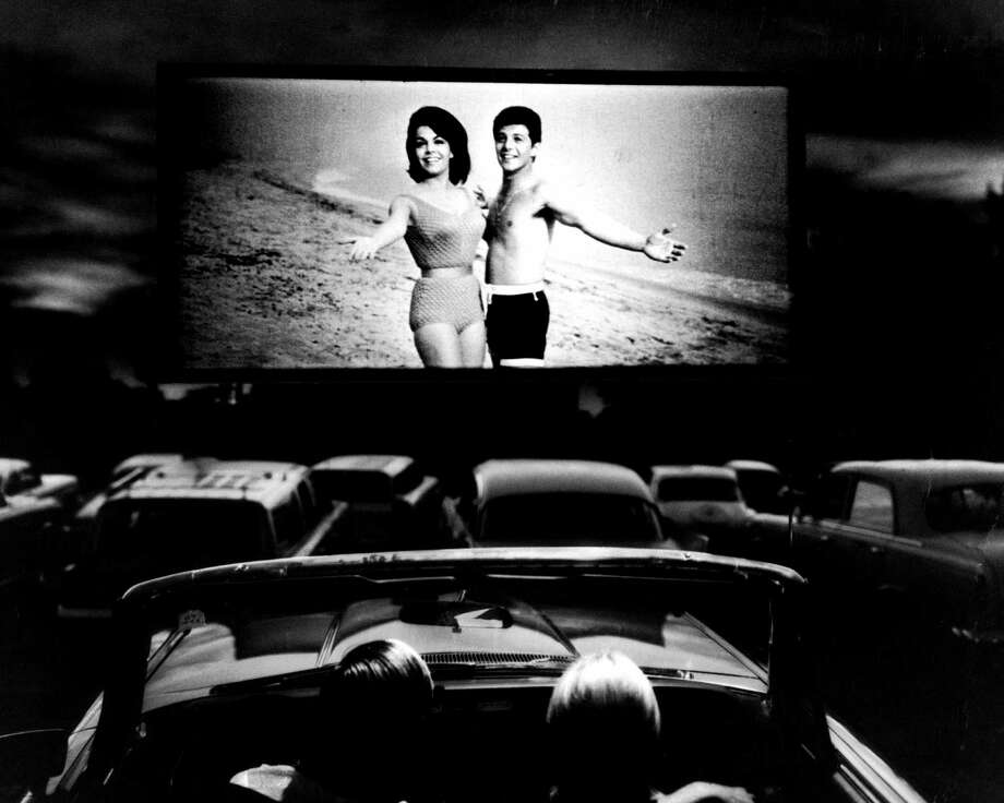 Actors Annette Funicello and Frankie Avalon in scene from the film Beach Blanket Bingo, shown at drive-in movie theater. Photo: Henry Groskinsky, File / Time Life Pictures