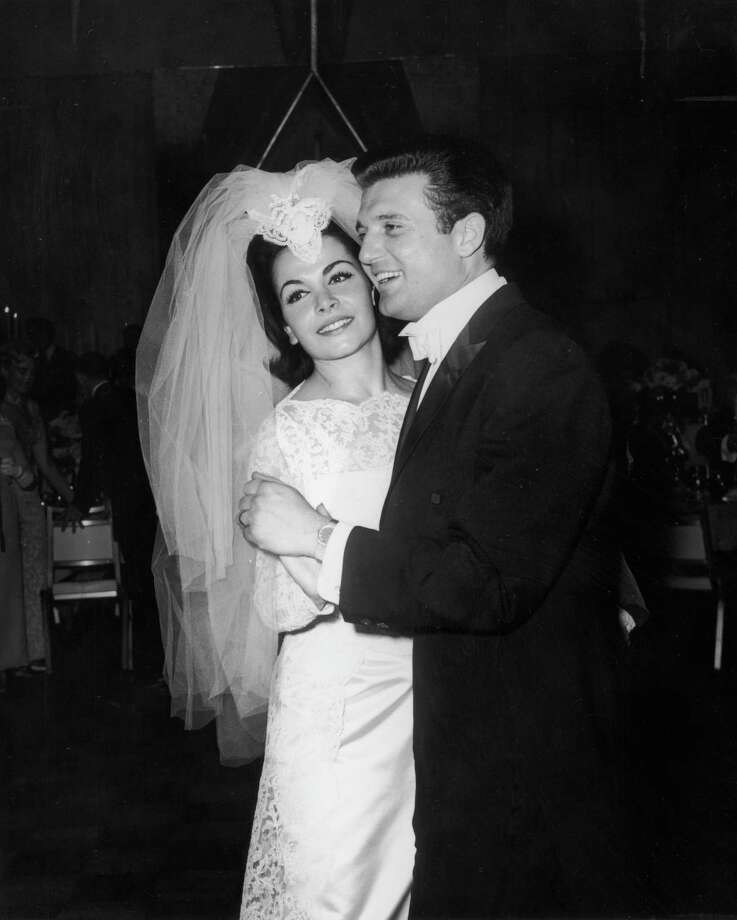 American actor and singer Annette Funicello smiles while dancing with her husband, agent Jack Gilardi, at their wedding reception in 1965. Photo: Hulton Archive, File / Archive Photos
