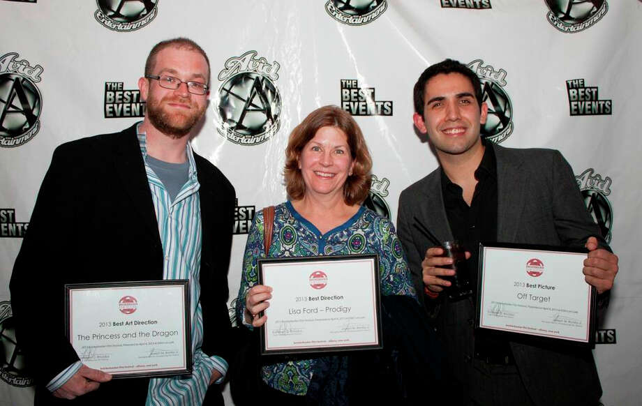 "From left to right: Mark Fiske (co-director of ""The Princess and the Dragon\""), Lisa Ford (director of \""Prodigy\""), and Bruce Wemple (director of \""Off Target\""), winners of Best Art Direction, Best Direction, and Best Picture, respectively. (Knickerbocker Film Festival)"
