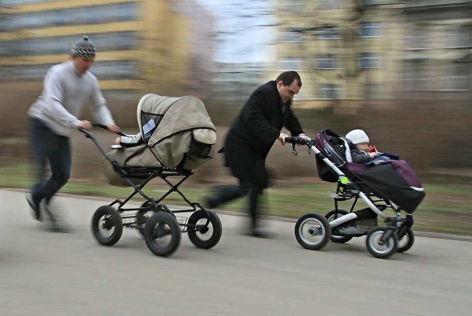 First comes love, then comes marriage,then comes Dad frantically pushing a baby carriage on Stroller Racing World Health Day in Brno, Czech Republic. Photo: Radek Mica, AFP/Getty Images