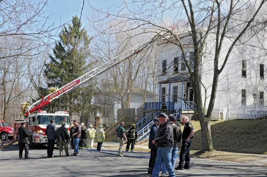 Firefighters work to put our a house fire on Young Glove Ave.  Monday, April 8, 2013 in Cohoes, N.Y. (Lori Van Buren / Times Union) Photo: Lori Van Buren