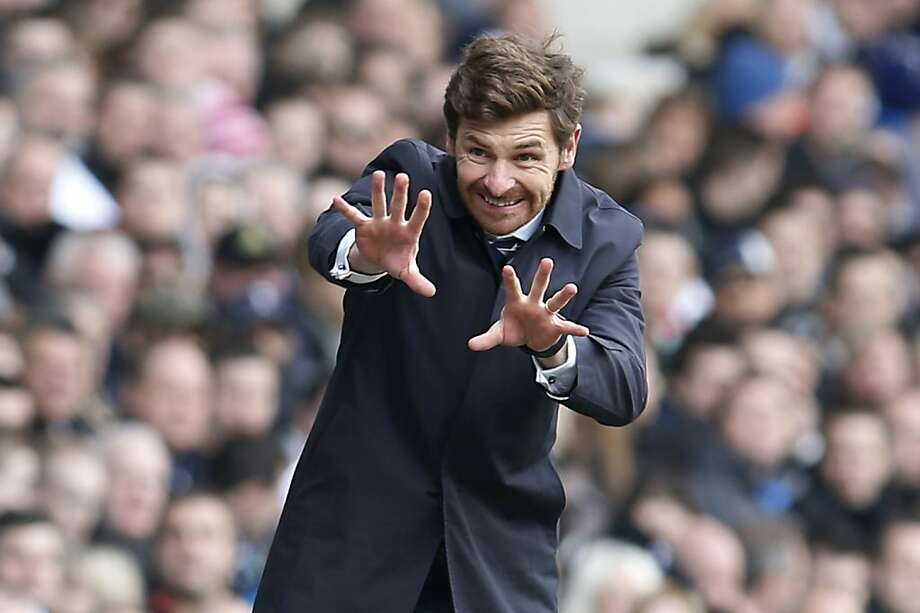 When all else fails ... Hoping to break a tie, Tottenham Hotspur coach Andre Villas-Boas puts a curse on Everton during an English Premier League soccer match in London. Photo: Sang Tan, Associated Press