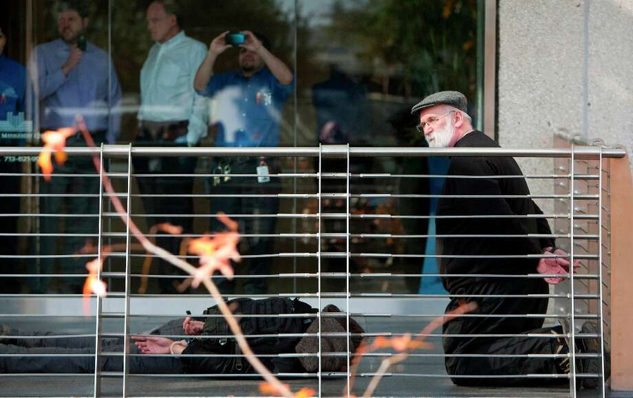 Members of the Tar Sands Blockade are arrested after protesting in front of a building containing an office for TransCanada, owner of the controversial Keystone XL pipeline. Photo: Cody Duty/Houston Chronicle, © 2012 Houston Chronicle / © 2012 Houston Chronicle