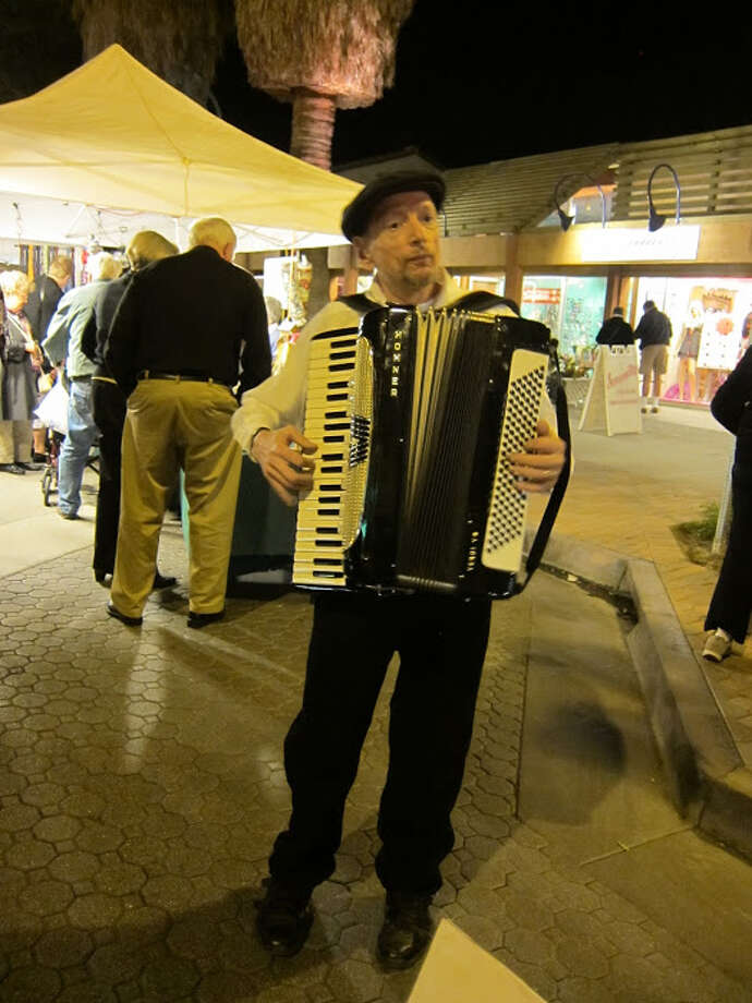 Every Thursday evening, the downtown Palm Spring VillageFest features farm-fresh food, art, crafts and free entertainment. Photo: For The Express-News