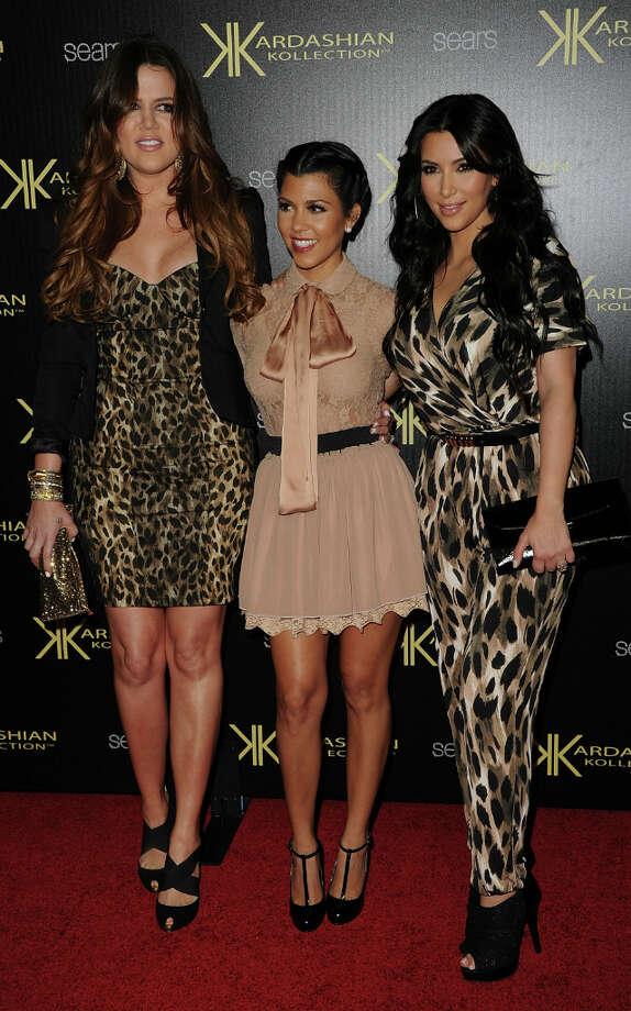 Khloe Kardasian, Kourtney Kardashian, and Kim Kardashian attend the Kardashian Kollection Launch Party at The Colony on August 17, 2011 in Hollywood, California. Photo: Jason Merritt, Getty / 2011 Getty Images