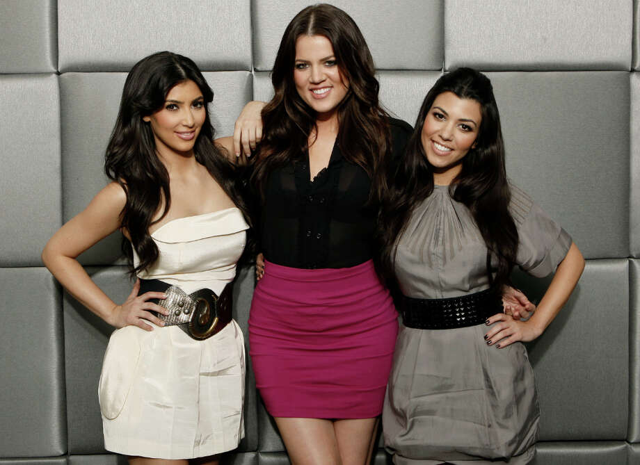 "Stars of the reality show ""Keeping Up with the Kardashians\"", Khloe Kardashian, center, Kim Kardashian, left, and Kourtney Kardashian pose for a portrait in Los Angeles on Thursday, March 26, 2009. Photo: Matt Sayles, AP / San Antonio Express-News"