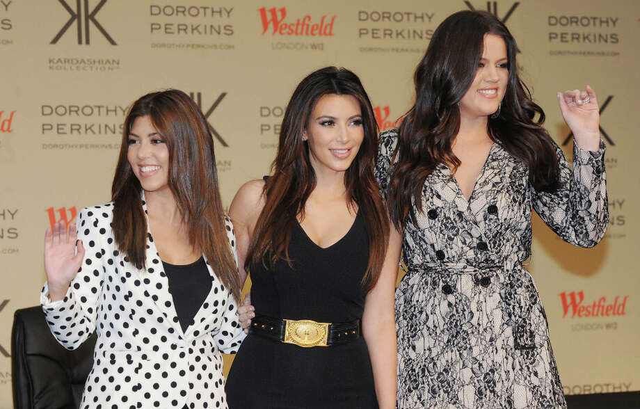 Kourtney Kardashian, Kim Kardashian and Khloe Kardashian Odom attend the photocall to launch the Kardashian Kollection in London, England. Photo: Stuart Wilson, Getty Images / 2012 Getty Images
