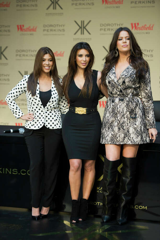 "Kourtney Kardashian, Kim Kardashian & Khloe Karashion seen at  Westfield shopping centre for the launch of the ""Kardashion Kollection\"" at Dorothy Perkins on Saturday, Nov.10 , 2012, in London.  (Photo by Ki Price/Invision/AP) Photo: Ki Price, Associated Press / Invision"