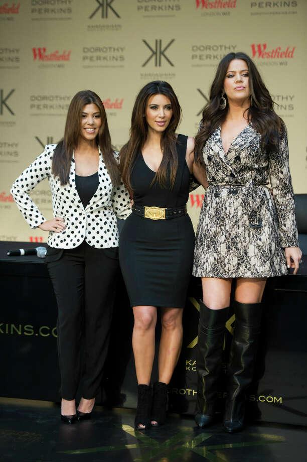 "Kourtney Kardashian, Kim Kardashian & Khloe Karashion seen at  Westfield shopping centre for the launch of the \""Kardashion Kollection\"" at Dorothy Perkins on Saturday, Nov.10 , 2012, in London.  (Photo by Ki Price/Invision/AP) Photo: Ki Price, Associated Press / Invision"