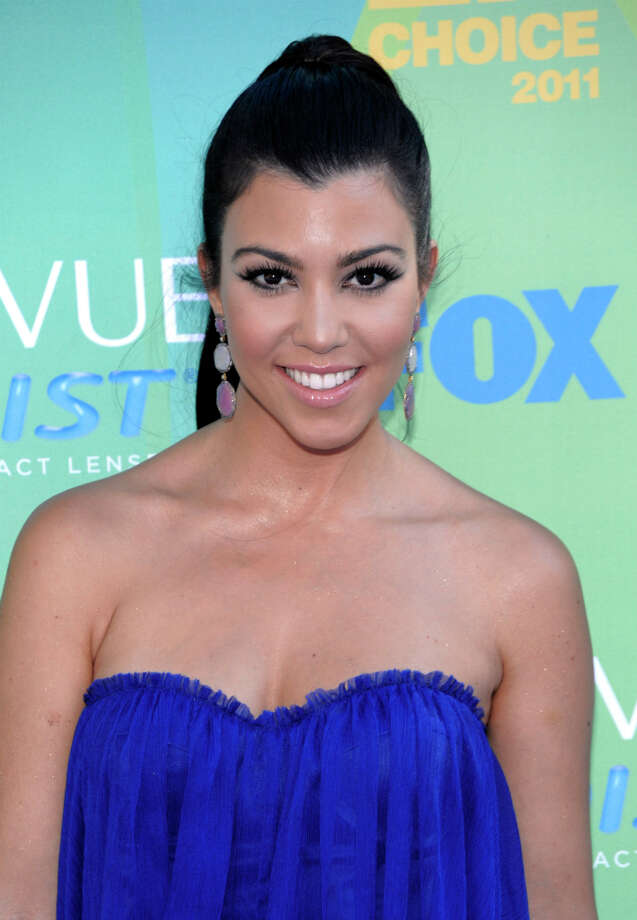 Kourtney Kardashian arrives at the Teen Choice Awards on Sunday, Aug. 7, 2011 in Universal City, Calif. (AP Photo/Dan Steinberg) Photo: Dan Steinberg, Associated Press / R-Steinberg