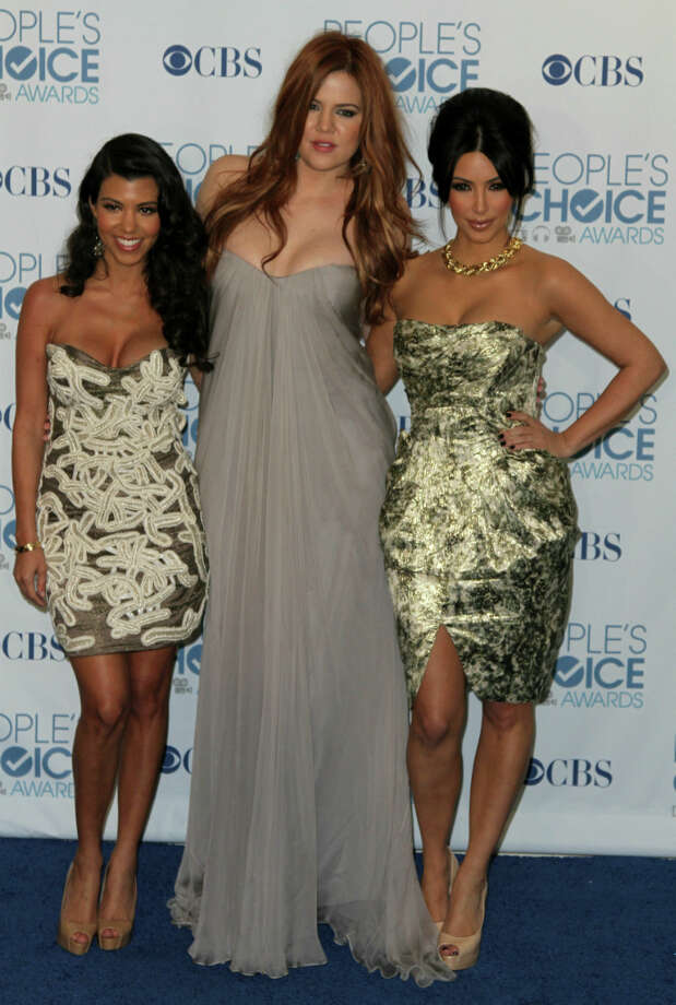 Kourtney Kardashian (L), Khloe Kardashian (C) and Kim Kardashian (R) pose at the People\'s Choice Awards in Los Angeles, California on January 5, 2011. AFP PHOTO/VALERIE MACON Photo: VALERIE MACON, AFP/Getty Images / AFP