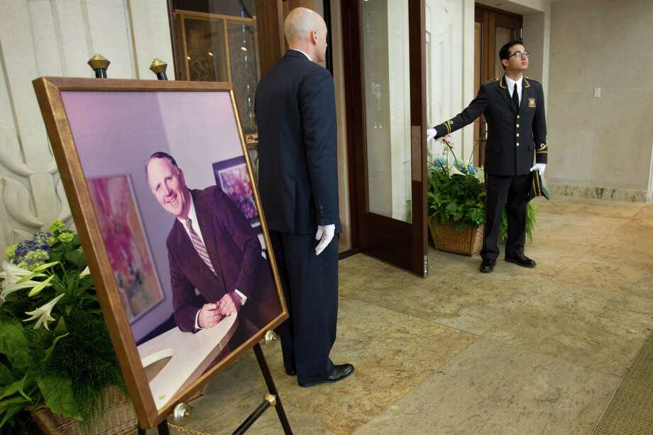 A portrait of Jack Pardee, the former University of Houston and Houston Oilers head coach, stands in the narthex at St. Michael Catholic Church during the funeral for the coach on Monday, April 8, 2013, in Houston. Photo: Brett Coomer, Houston Chronicle / © 2013 Houston Chronicle