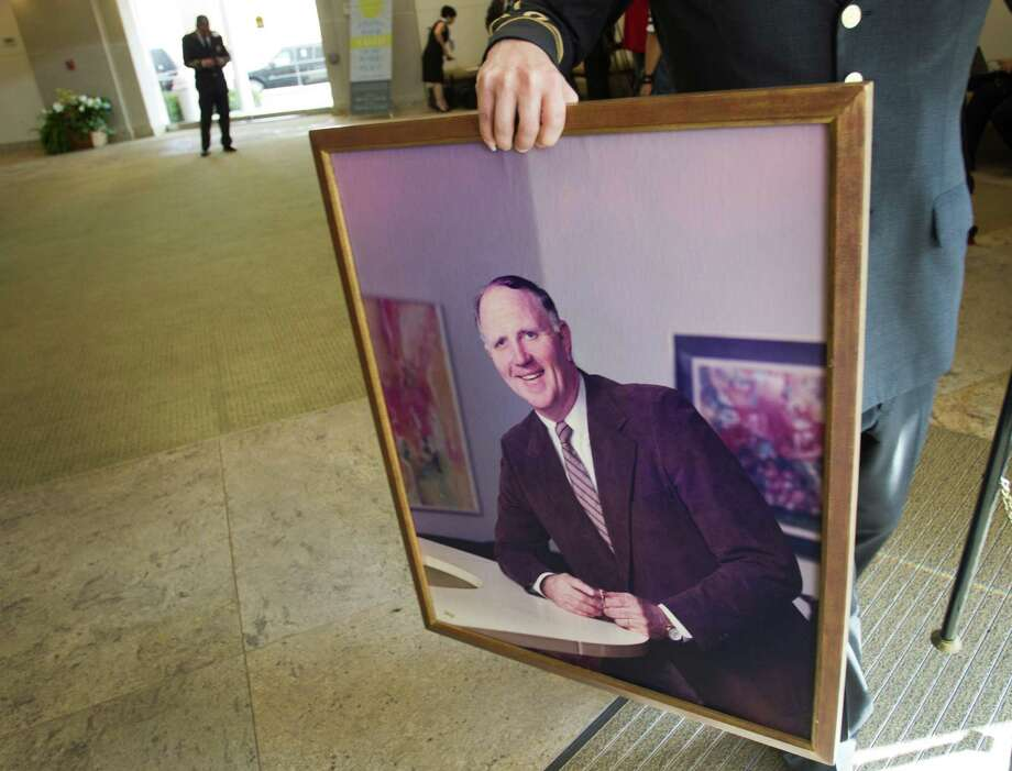 A portrait of Jack Pardee, the former University of Houston and Houston Oilers head coach, is taken out of St. Michael Catholic Church following the funeral for the coach. Photo: Brett Coomer, Houston Chronicle / © 2013 Houston Chronicle