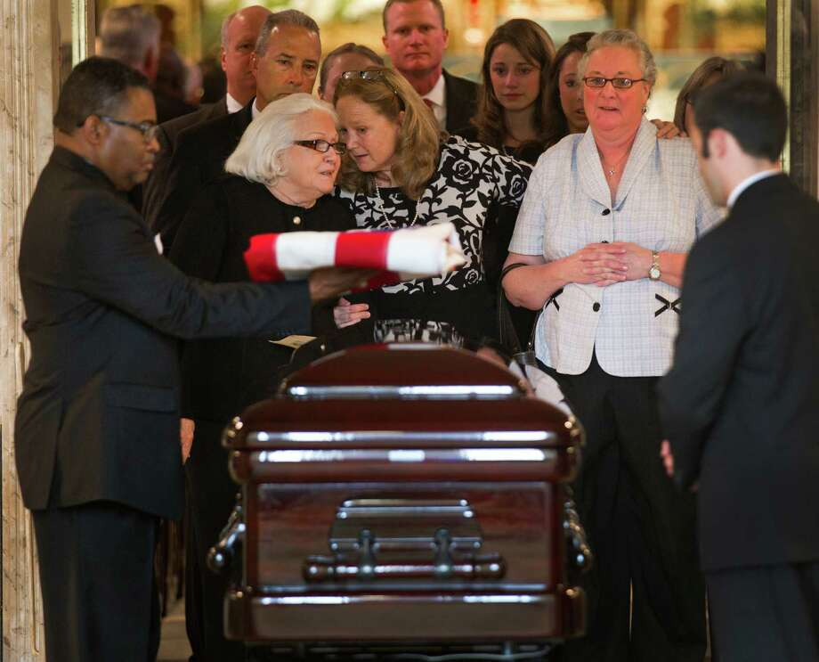 Widow Phyllis Pardee, left, and her daughters Judee Pardee Peterson, center, and Anne Pardee pause behind the casket of Jack Pardee, the former University of Houston and Houston Oilers head coach, following the funeral for the coach at St. Michael Catholic Church on Monday, April 8, 2013, in Houston. Photo: Brett Coomer, Houston Chronicle / © 2013 Houston Chronicle