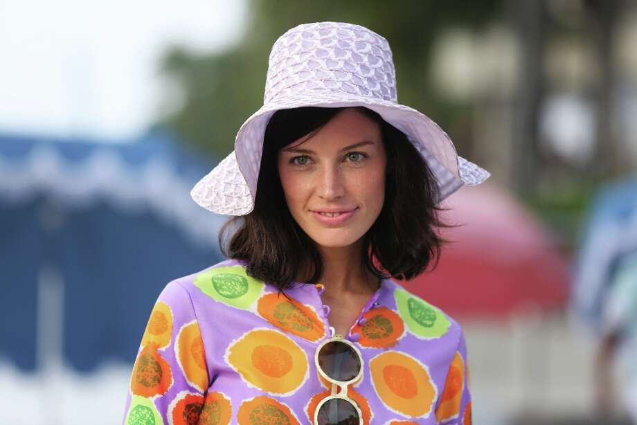 Jessica Pare tries out a citrusy coat dress in Hawaii. Photo: Michael Yarish, Associated Press / AMC