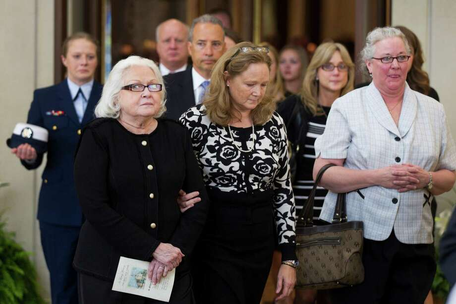Phyllis Pardee, left, and her daughters, Judee Pardee Peterson, center, and Anne Pardee walk out of the church following the funeral for Jack Pardee, the former University of Houston and Houston Oilers head coach, at St. Michael Catholic Church on Monday, April 8, 2013, in Houston. Photo: Brett Coomer, Houston Chronicle / © 2013 Houston Chronicle