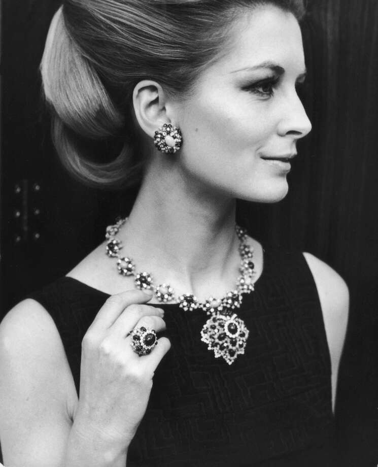 Sandra Paul modelling a lapis turquoise diamond necklace with matching ring, ear-clips and pendant at the opening of jewellery designer David Morris\' showroom in Mayfair, May 21, 1969. The set is valued at $40,000. Sandra Paul\'s third marriage was to Conservative politician Michael Howard. Photo: Hulton Archive, Getty Images / 2003 Getty Images