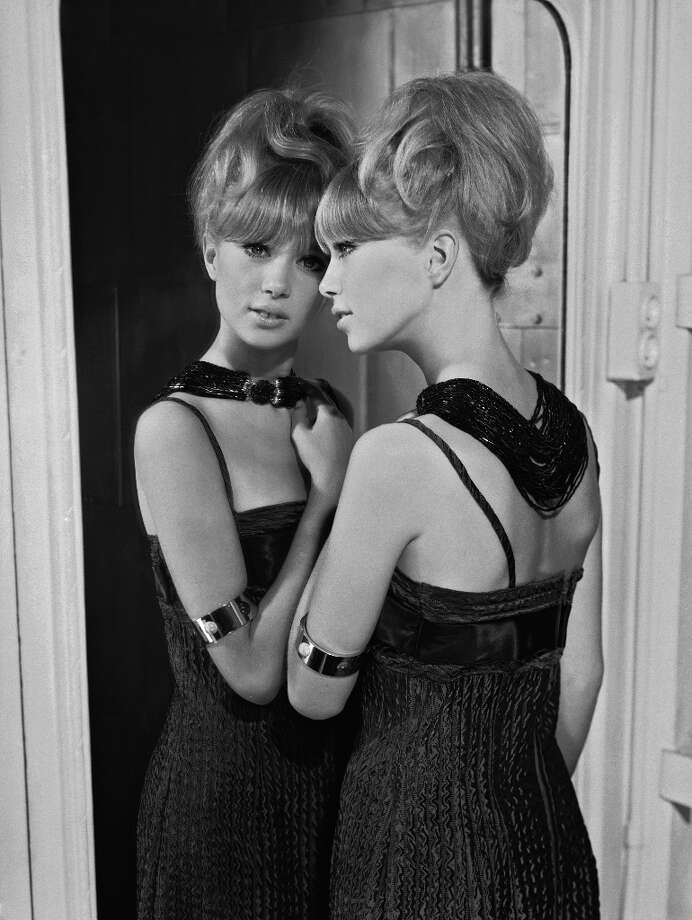 1964: Patti Boyd in a bare-shouldered evening dress and an elaborate bead necklace. Photo: Chaloner Woods, Getty Images / Hulton Archive