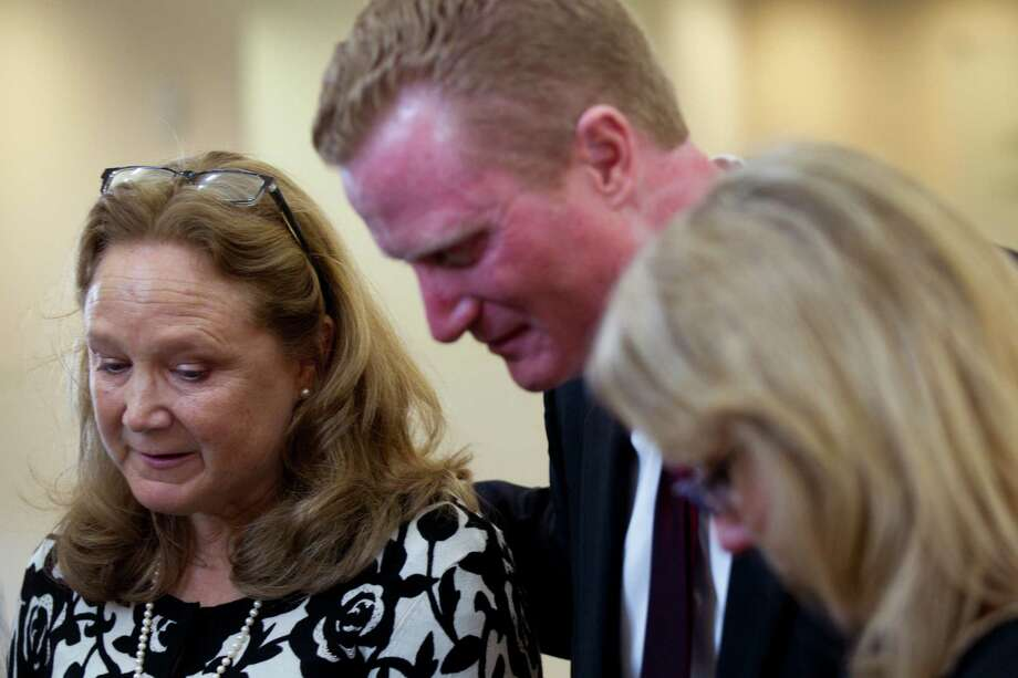 Judee Pardee Peterson, left, Ted Pardee and Susan Brown pause to speak to the medial following the funeral for their father, Jack Pardee, the former University of Houston and Houston Oilers head coach, at St. Michael Catholic Church on Monday, April 8, 2013, in Houston. Photo: Brett Coomer, Houston Chronicle / © 2013 Houston Chronicle