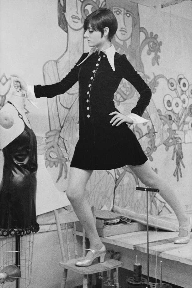 American fashion designer Betsey Johnson stands on a table and a chair as she poses for a portrait in her studio, New York, September 6, 1966. Photo: Susan Wood/Getty Images, Getty Images / 2006 Getty Images