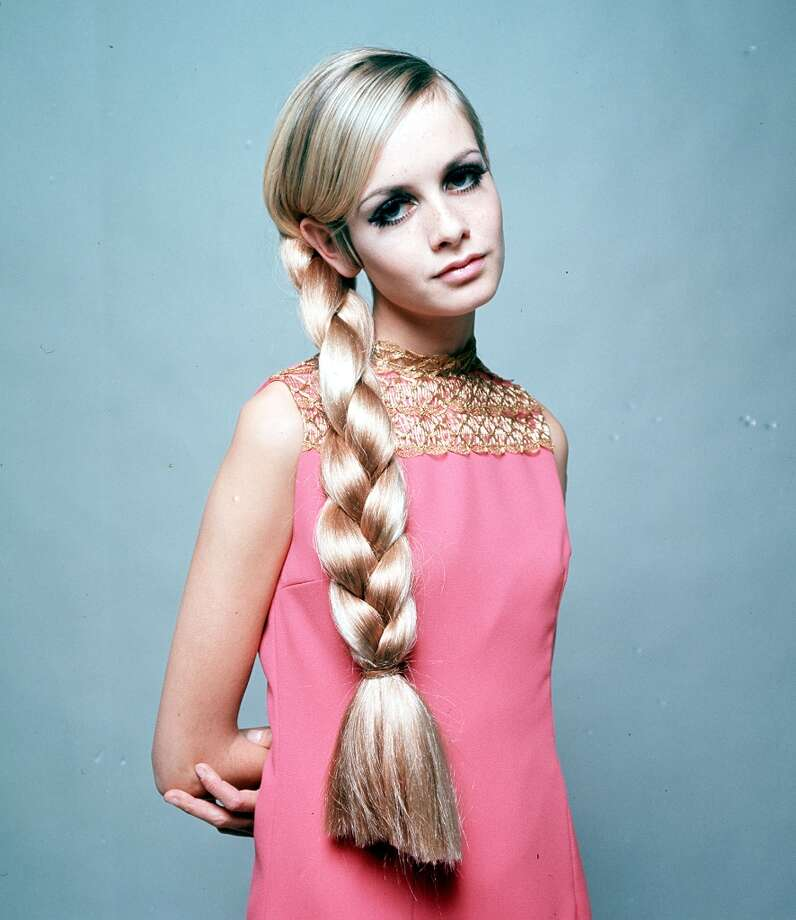 Dec. 3, 1966, A portrait of model Twiggy wearing a fashionable pink dress and a large plat in her long hair. Photo: Popperfoto, Popperfoto/Getty Images / Popperfoto