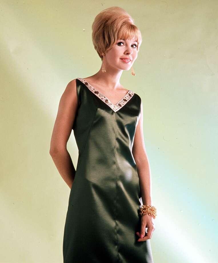 Sept. 3, 1966, A studio portrait of a model wearing an fashionable elegant green evening dress. Photo: Popperfoto, Popperfoto/Getty Images / Popperfoto