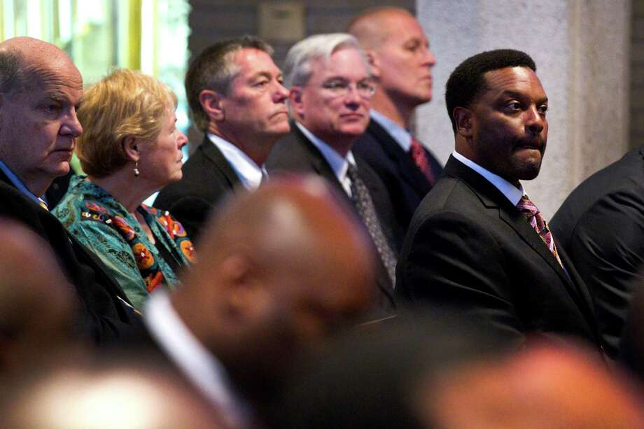 Texas A&M head coach Kevin Sumlin attends the funeral for Jack Pardee, the former University of Houston and Houston Oilers head coach, at St. Michael Catholic Church on Monday, April 8, 2013, in Houston. Photo: Brett Coomer, Houston Chronicle / © 2013 Houston Chronicle
